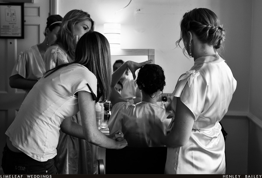 Bride indicates how she wants her wedding hair while surrounded by her bridesmaids at The Abode Hotel in Exeter